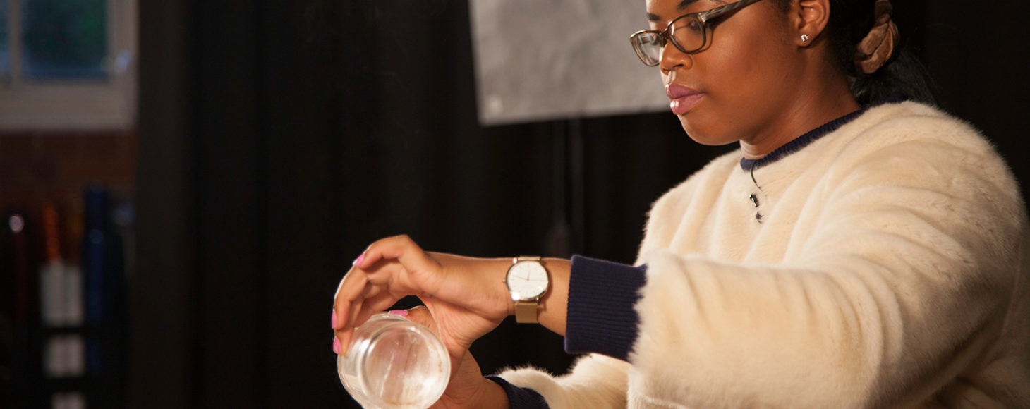 Florence Adepoju, a cosmetic science student at London College of Fashion is mixing chemicals for one of her products