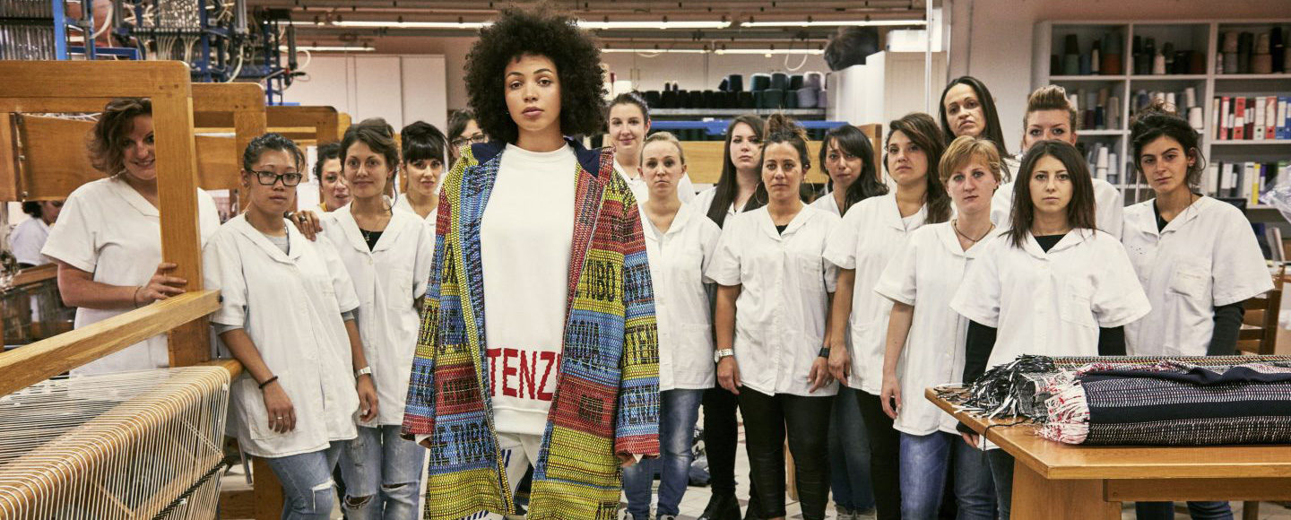 A jacket is shown designed by Bethany Williams in a studio