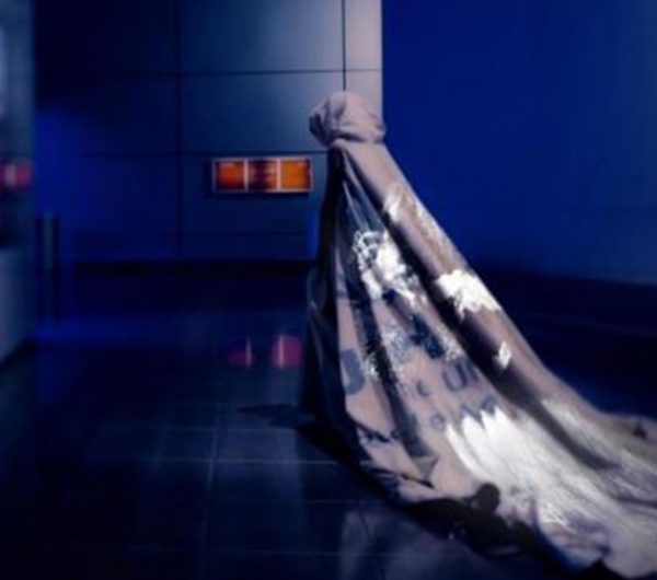 A model walks wearing a dress designed by Helen Storey, the installation showcase the data visulaisation