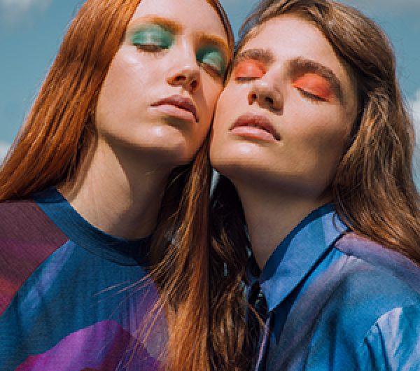 Two female models wearing blue garments