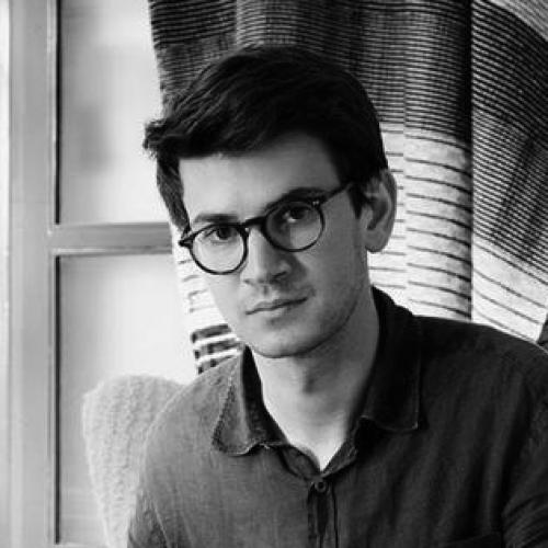 black and white portrait of Sam Reich