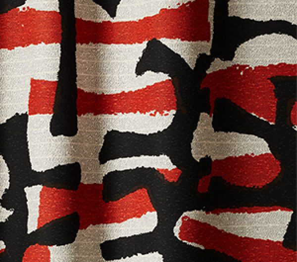 Woven fabric with red and black pattern